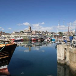 Penzance harbour on a still, sunny day