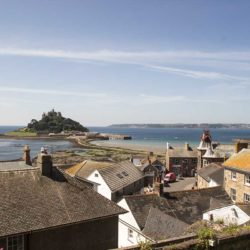 Rooftop view over Marazion from Back Lane showing St Michael's Mount and the Town Hall